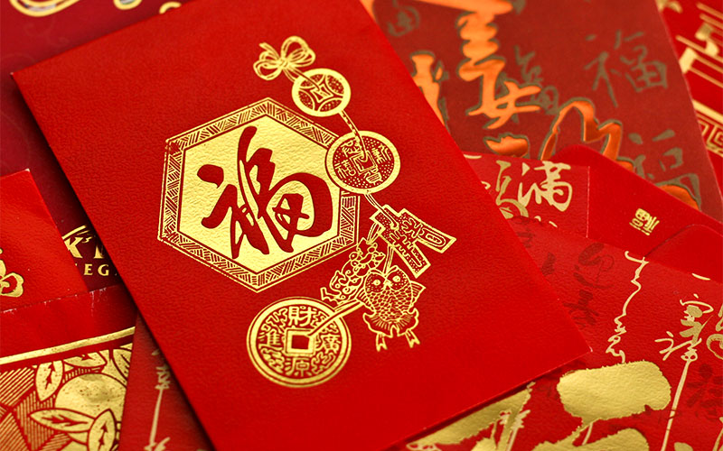 red envelopes known as lai see are traditionally gifted over the lunar new year period usually from the married to the unmarried